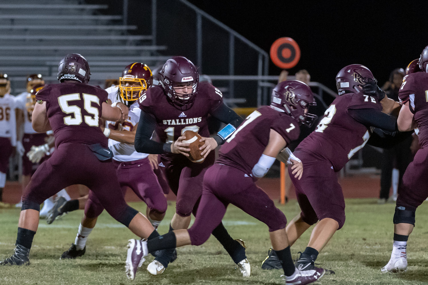 While Shadow Ridge senior quarterback Kaiden Lansford drops back after faking a handoff to senior tailback Michael Clark, junior offensive tackle Jack Chappelle (No. 55) and junior offensive guard Chris Stoica (No. 72) block during a Sept. 27,2019 game against Tolleson. Chappelle and Stoica are back to lead a new-look Stallions offense.