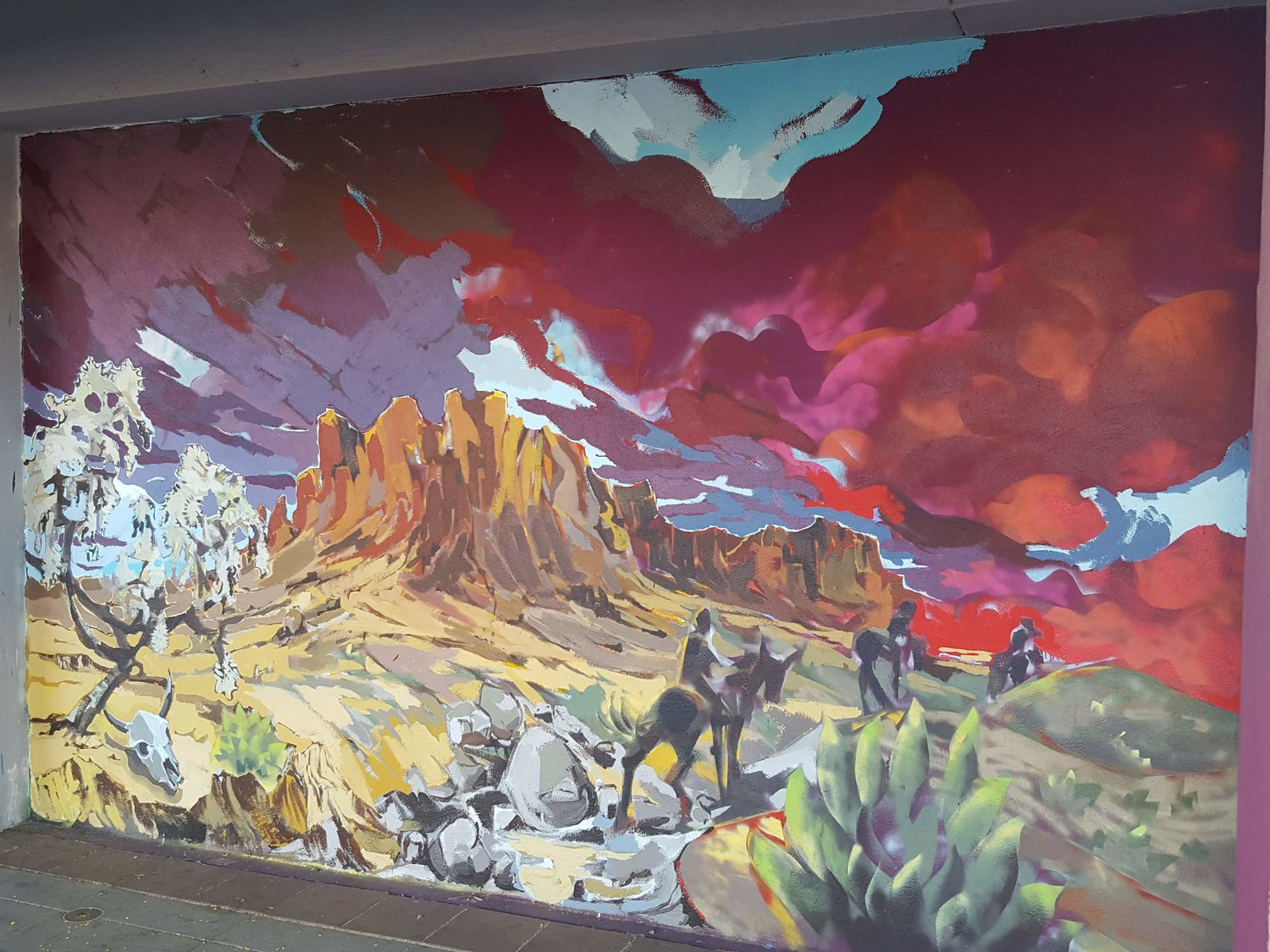"Superstition Riders,"" 8-by-13-foot mural, acrylic and aerosol, MacDonald and Main Street, Mesa, 2018."