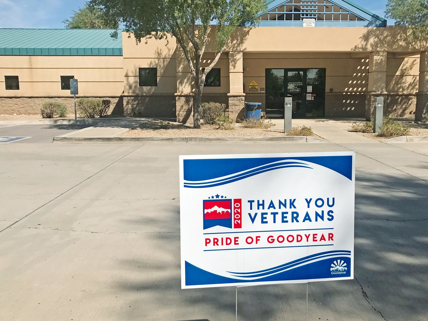 Signs like this one at the Goodyear Recreation Office are popping up all over the city as part of Goodyear's COVID-compliant Veterans Day Tribute.
