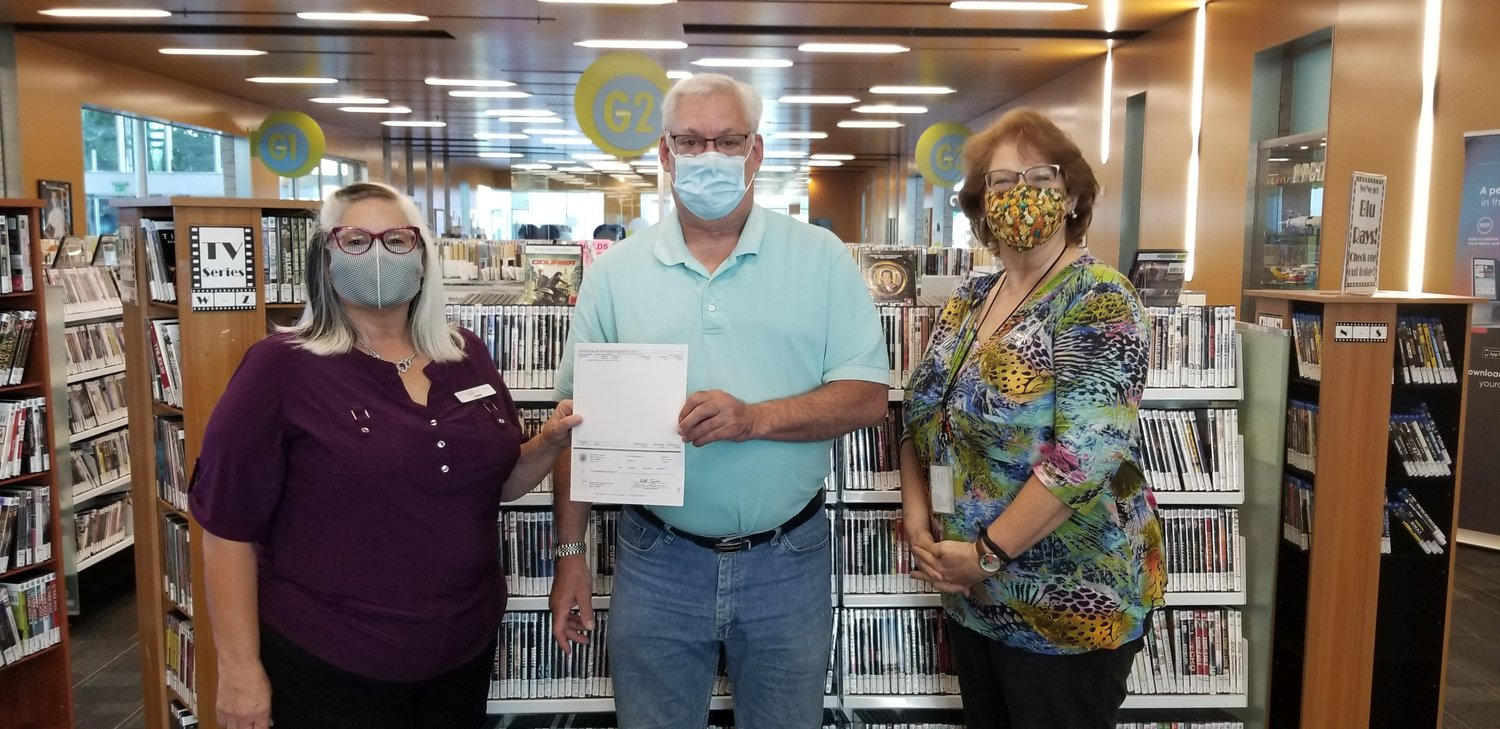 Councilman Jon Edwards presented a check to the Friends of the Peoria Public Library President Jane Cicinelli (left) and Kathleen Wade (right), library systems administrator, in honor of the dedication of the friends to the Peoria Public Library system.