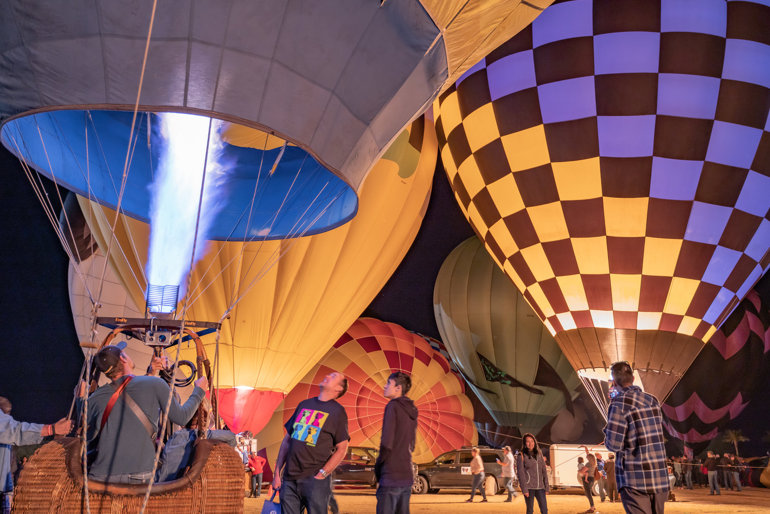 Arizona Balloon Classic attendees can view illuminated hot air balloons as they glow in time to music during Desert Glows.