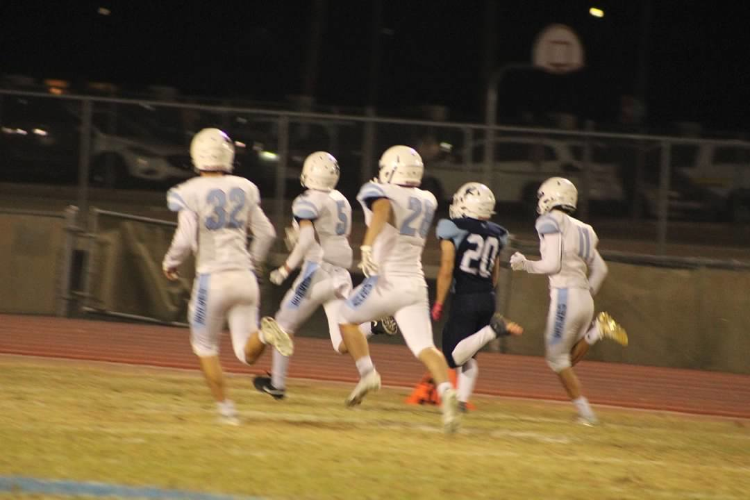 Deer Valley junior Steven Magnusson returns a kickoff for more than 60 yards early in the second quarter as Estrella Foothills senior Brian Tas (#5) and a host of Wolves give chase.
