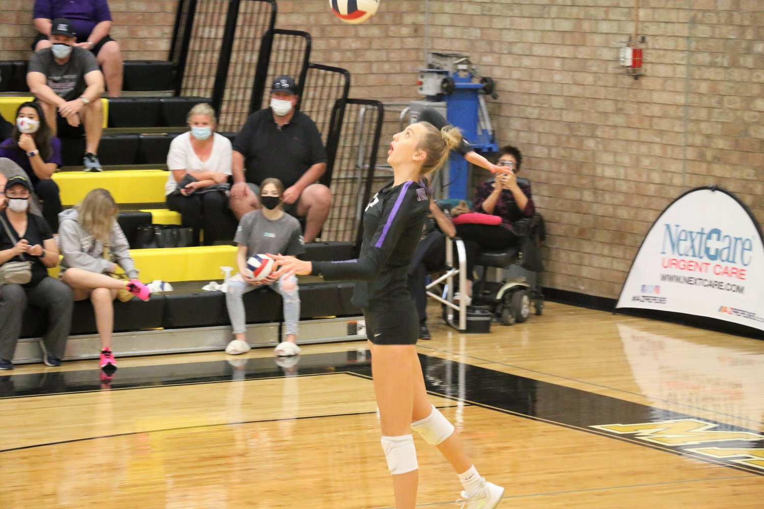 Northwest Christian senior middle blocker Reagan Hope prepares to serve during the state 3A volleyball final Nov. 21 at Marcos de Niza High School in Tempe.