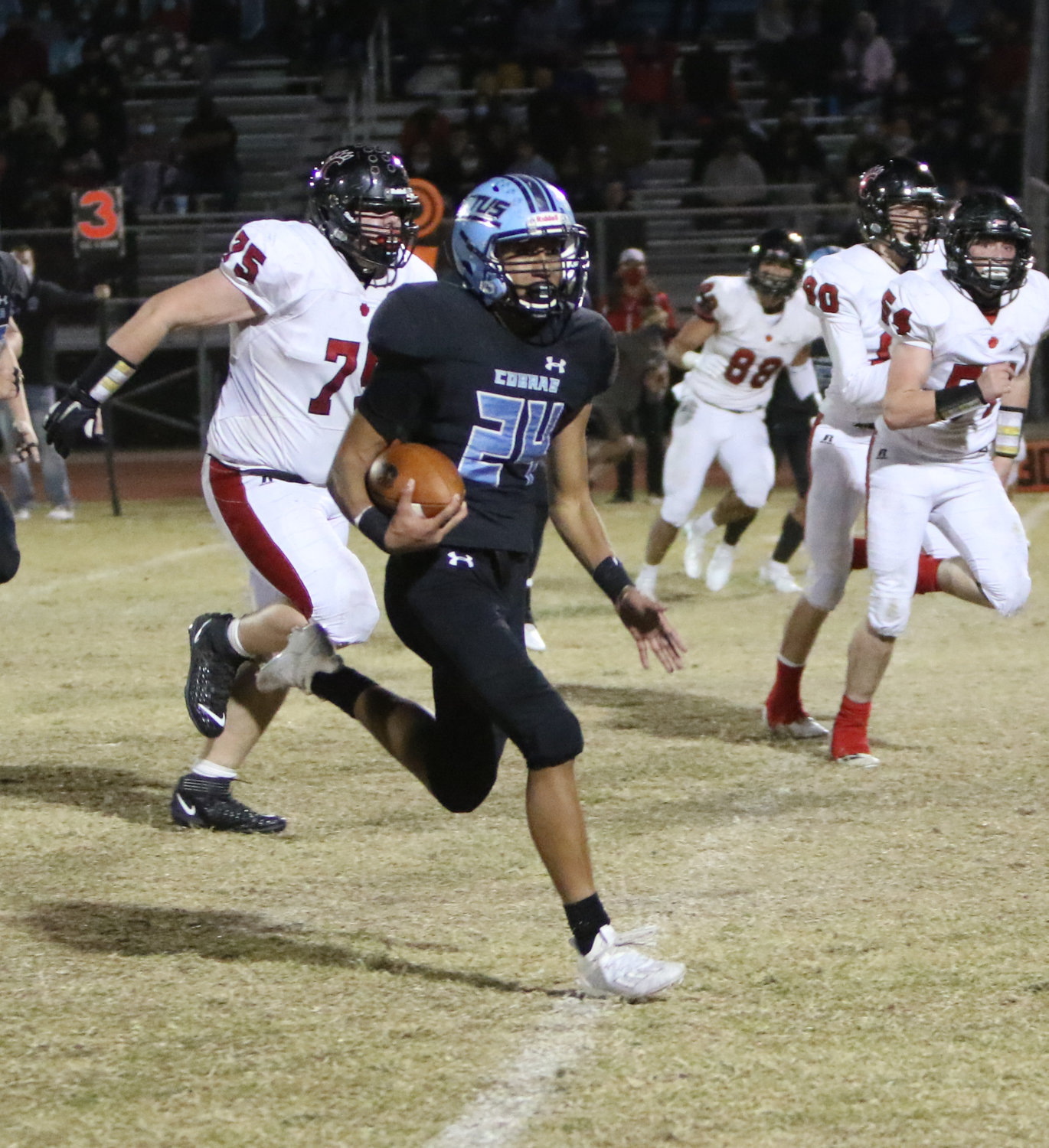 Cactus sophomore Tovia Vito breaks into the open field in the Cobras 41-7 4A quarterfinal win over Flagstaff Coconino Nov. 27 in Glendale.