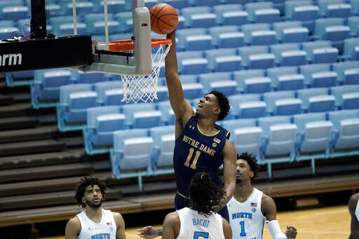 Notre Dame forward Juwan Durham (11) drives to the basket against North Carolina forward Armando Bacot (5) and guard Leaky Black (1) during the second half of an NCAA college basketball game in Chapel Hill, N.C., Saturday, Jan. 2, 2021. (AP Photo/Gerry Broome)