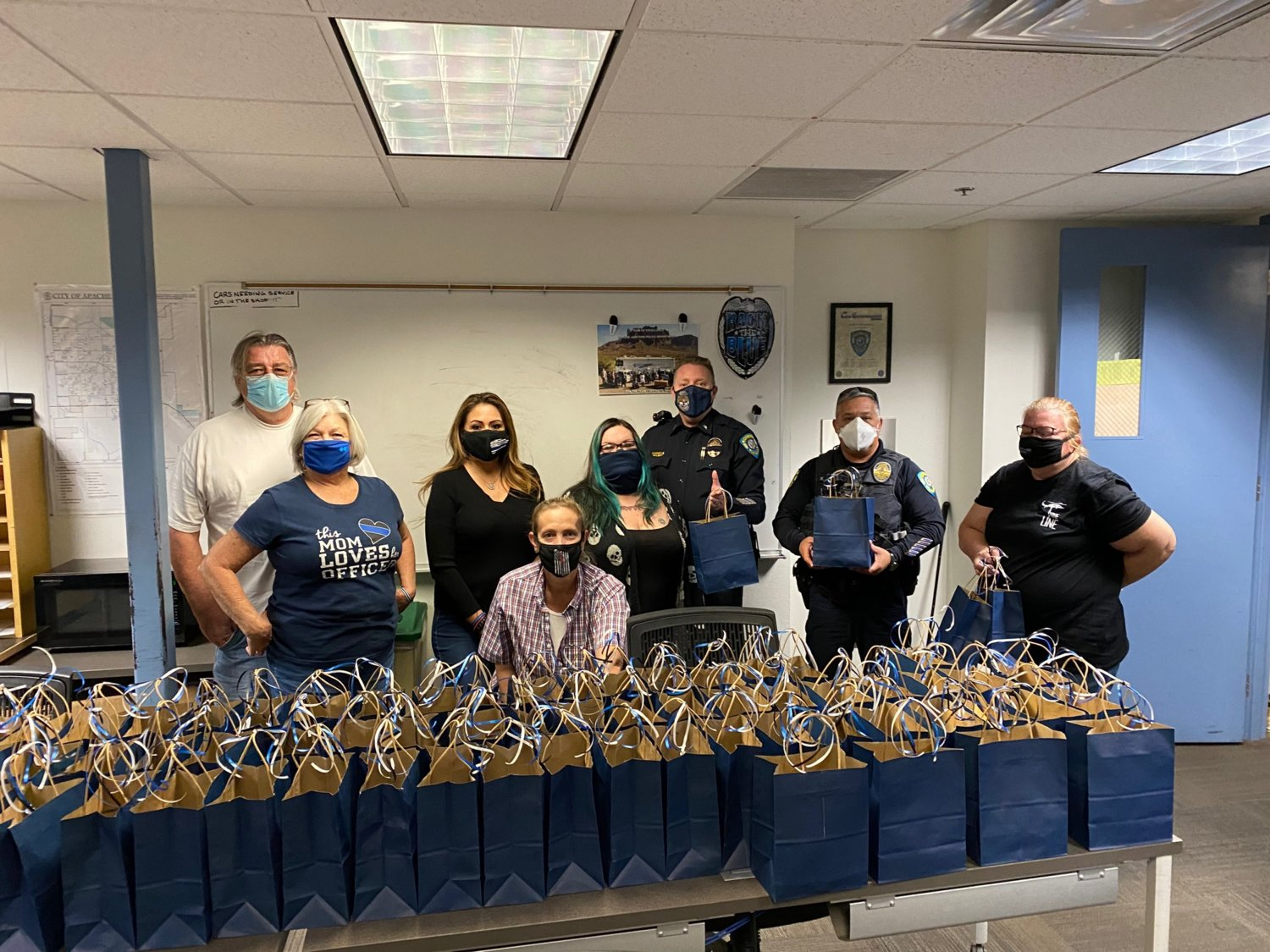 From left are Thank You AZ Blue members Roy Mills, 65; Sunny Mills, 66; Lucinda Anderson, 47; Mia Paris, 50; Margarita Gordon, 31; and Kimberly Hofbauer, 59; with Apache Junction Police Department Lt. Thom Parker and Officer Keith Gabriel.