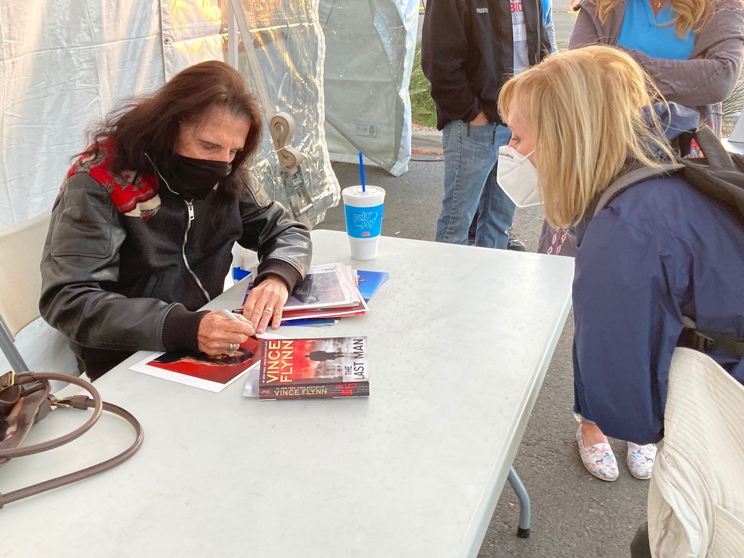 Alice Cooper signs an autograph for Abrazo West Campus vaccination POD volunteer Keely Moran of Paradise Valley.