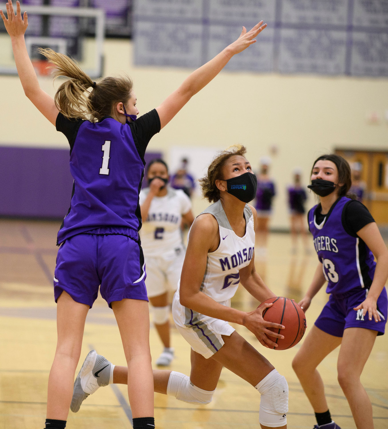 Valley Vista junior forward Mikela Cooper ducks under the defense of Millennium freshman forward Elli Guiney (#1) while sophomore guard Mia Amundsen (#13) looks on during their Feb. 17 game at Valley Vista High School in Surprise. Cooper is a first team all West Valley Preps player.