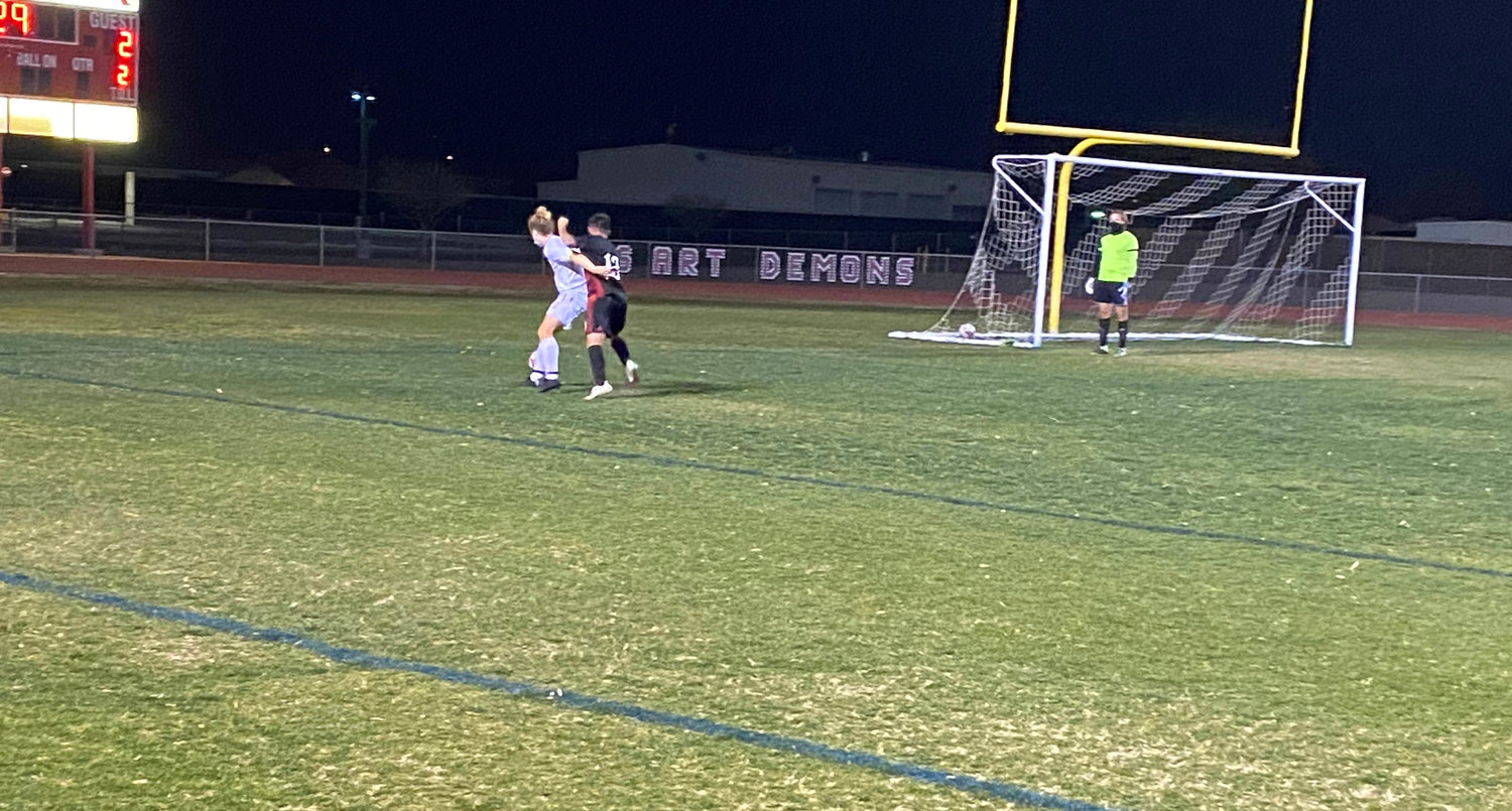 Saguaro junior defender Charlie Gilbreath walls off Dysart junior Eduardo Cruzes in the Saguaro area during the second half of their Feb. 19 4A soccer match at Dysart High School in El Mirage.