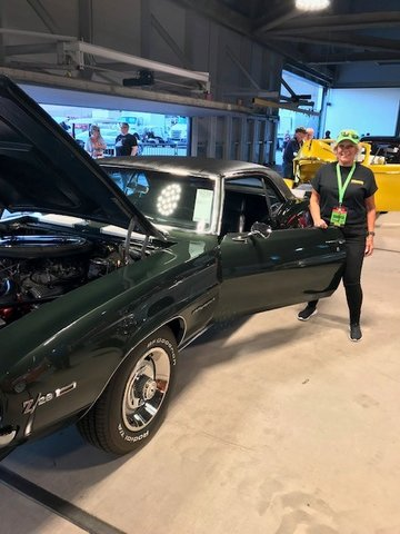 Sun City resident Carol McDade prepares to drive a Camaro Z28 during a previous Mecum Auction. She volunteers at the event for the chance to drive some cool cars.