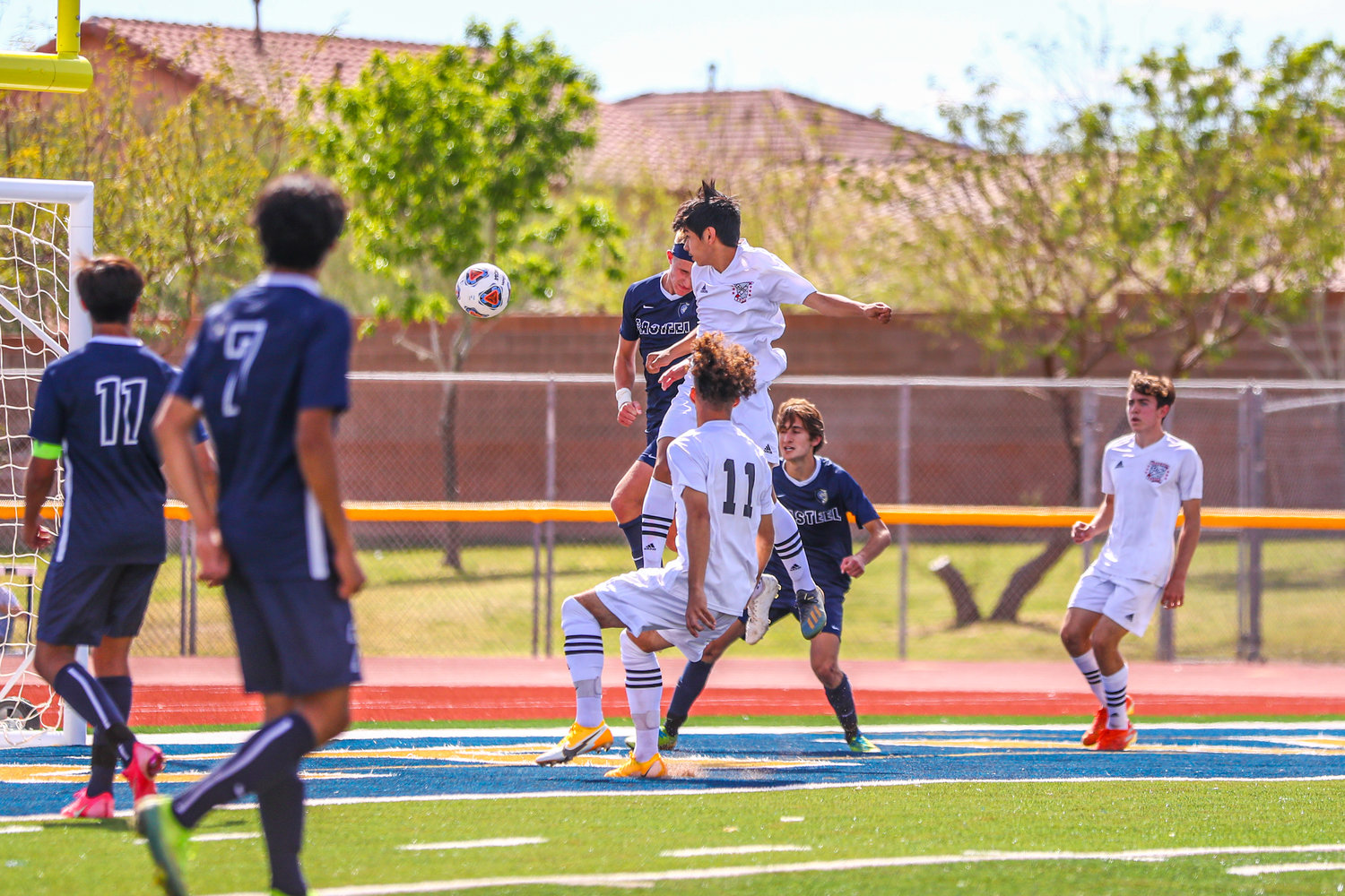 Ironwood junior midfielder Gabriel Ayala heads in the Eagles second goal of an 8-2 loss to Queen Creek Casteel in the 5A boys soccer final March 20 at Desert Vista High School in Phoenix.