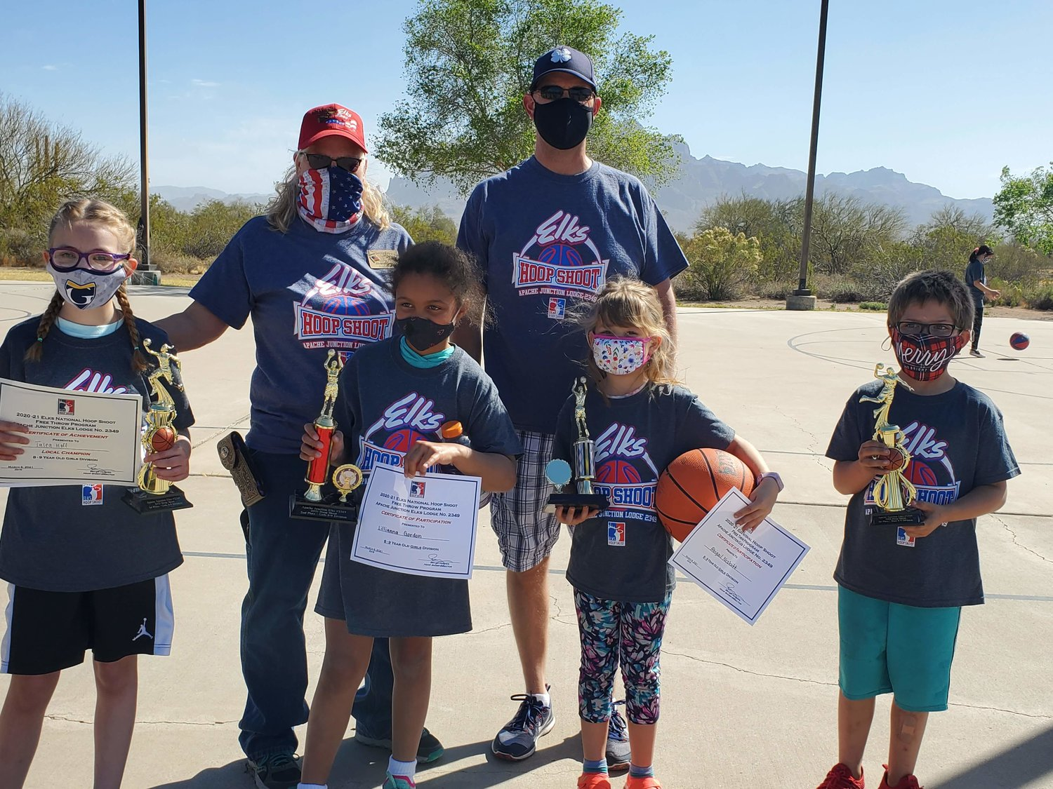 Front row, from left, in the Girls 8-9 Division, Talea Hoff finished in first place, Lillianna Gordon in second place and Abigail Nesbitt in third place. In the Boys 8-9 Division, James Danison finished in first place at the Hoop Shoot hosted by Apache Junction Elks Lodge No. 2349.