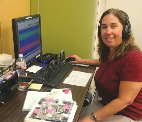 Nicole Caliguiri, a volunteer librarian, converts old radio cassettes to digital format for use in both the West Valley Talking News and on air at KRUV. [Submitted photo]