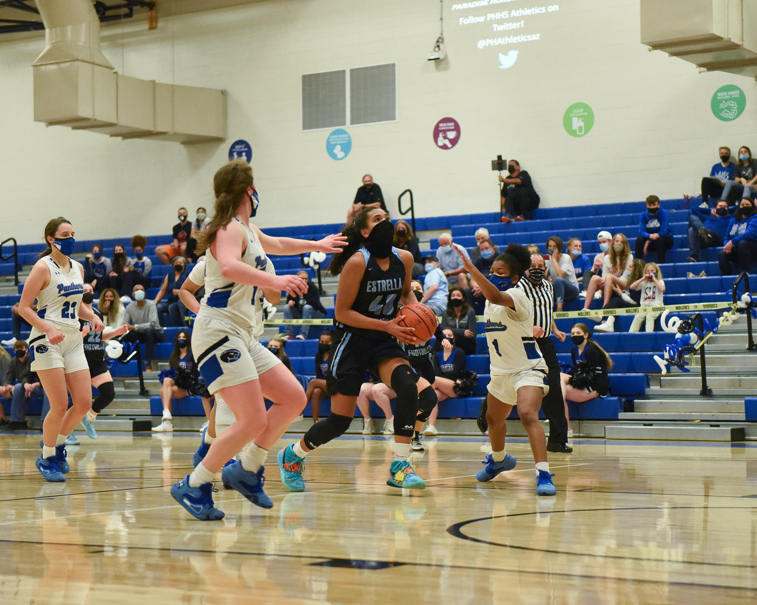 Estrella Foothills senior forward Kennedy Harper drives down the lane while Paradise Honors freshman guard Nakyah Williams (No. 1) and junior guard Addison Sandusky (No. 14) converge on her March 5 at Paradise Honors High School in Surprise. Harper is the runner up for West Valley Preps player of the year.