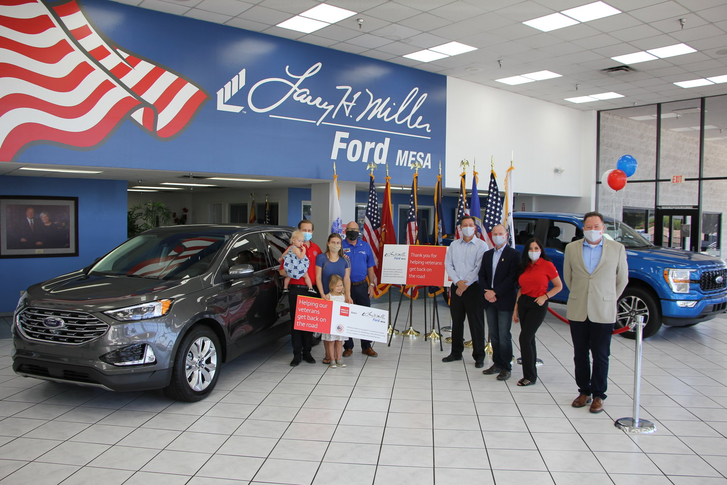 Retired U.S. Army Spc. Phillip Rousu and his family participated in a key ceremony at Larry H. Miller Ford Mesa, 460 E. Auto Center Drive, where he was recognized for his service and given the keys to his vehicle.