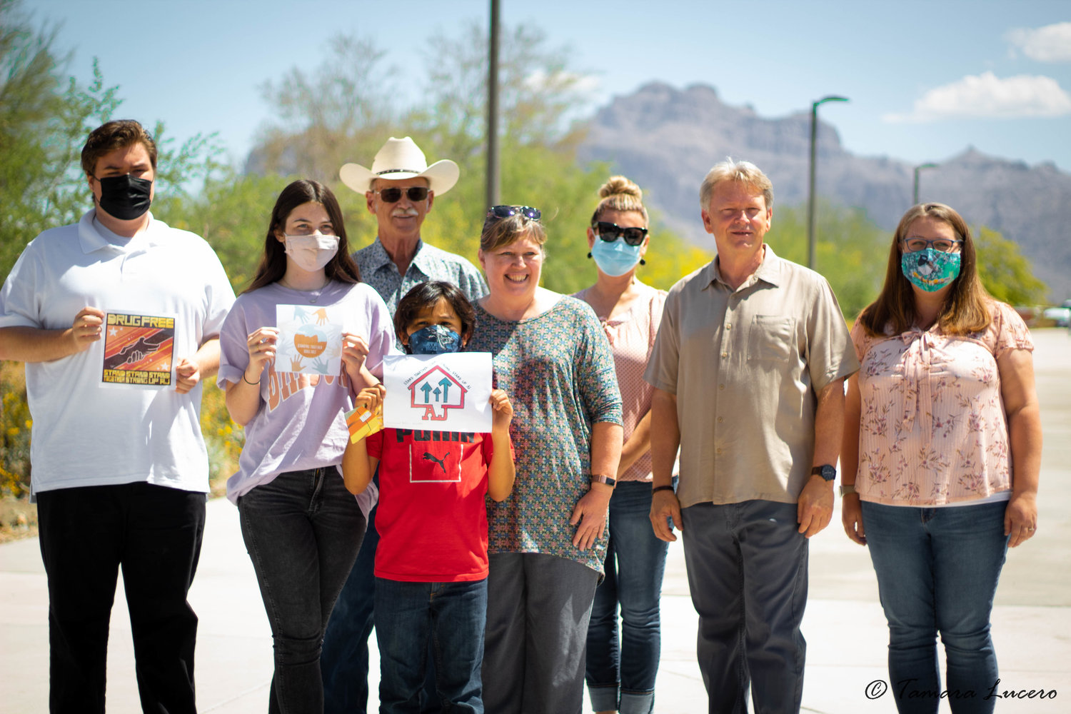 From left are Gabriel (Xander) Embury; Kylee McDonald; Apache Junction Mayor Chip Wilson; Shelly Verley, StandUp AJ's coordinator; Pat Smith, principal of Desert Vista Elementary School and a member of StandUP AJ; Mike Harding, pastor of Love Gospel Church, who was instrumental in getting the contest and luncheon accomplished; Miriam Wilson, a school teacher; and in the front is Quetzalcoatl Pablos Arguelles.